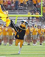 "August 31 2013: Iowa Hawkeyes mascot ""Herky"" takes the field before the start of the NCAA football game between the Northern Illinois Huskies and the Iowa Hawkeyes at Kinnick Stadium in Iowa City, Iowa on August 31, 2013. Northern Illinois defeated Iowa 30-27."