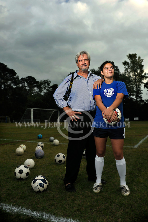 Portrait of an athelete with her supporting father.