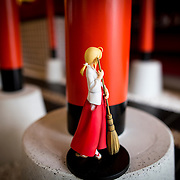 "TOKYO, JAPAN - JUNE 27 : Anime figure displayed at the entrance of Akihabara shrine in Akihabara, Tokyo, Japan on June 27, 2016. A newly opened Akihabara Shrine offers a memorial services for ""deceased"" anime figures. Photo by Richard Atrero de Guzman"