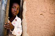 Boy peeking out of a door. Northern Ghana, Thursday November 13, 2008.