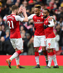 Pierre-Emerick Aubameyang of Arsenal celebrates his goal with Alexandre Lacazette of Arsenal and Calum Chambers of Arsenal - Mandatory by-line: Alex James/JMP - 01/04/2018 - FOOTBALL - Emirates Stadium - London, England - Arsenal v Stoke City - Premier League