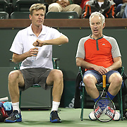 March 1, 2014, Indian Wells, California: <br /> Peter Fleming and John McEnroe chat between games during the McEnroe Challenge for Charity presented by Esurance. <br /> (Photo by Billie Weiss/BNP Paribas Open)