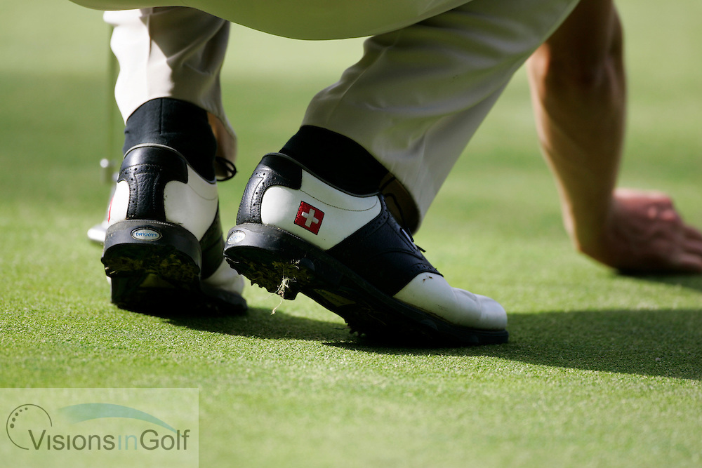 Damien Ulrich shoes showing the swiss flag during the second round  at the Omega European Masters 2006, Crans Montana, Switzerland, 8th September 2006<br /> Picture Credit: Mark Newcombe / visionsingolf.com