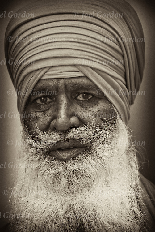 "Sikh-Americans show ethnic pride, man with turban usually means he's a Sikh. Religion is called Sikhism, come from the state of Punjab in India, belive in one g-d and do not worship idols, fifth largest monotheistic religion. call g-d ""Wahegura"" meaning ""the supreme tearcher"" never cut their hair, believe that men and women are born equal, in monogramy and reincarnation. Since 9-11, some Sikhs have be mistaken for terrorists and became targets of hate crimes, including murder."