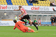 Danny Wright wins his penalty after being tackled by Fabian Speiss during the Vanarama National League match between Torquay United and Cheltenham Town at Plainmoor, Torquay, England on 29 August 2015. Photo by Antony Thompson.