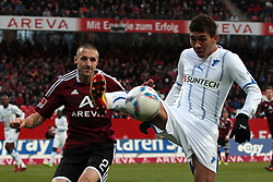 10.12.2011, easy Credit Stadion, Nuernberg, GER, 1.FBL, 1. FC Nürnberg/ Nuernberg vs TSG 1899 Hoffenheim, im Bild:Timmy Simons (Nuernberg #2) im Zweikampf mit Roberto Firmino (Hoffenheim #22). // during the Match GER, 1.FBL, 1. FC Nürnberg/ Nuernberg vs TSG 1899 Hoffenheim on 2011/12/10, easy Credit Stadion, Nuernberg, Germany..EXPA Pictures © 2011, PhotoCredit: EXPA/ nph/ Will..***** ATTENTION - OUT OF GER, CRO *****