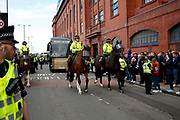 Mounted police escort the team bus of Celtic FC before the Ladbrokes Scottish Premiership match between Rangers and Celtic at Ibrox, Glasgow, Scotland on 1 September 2019.