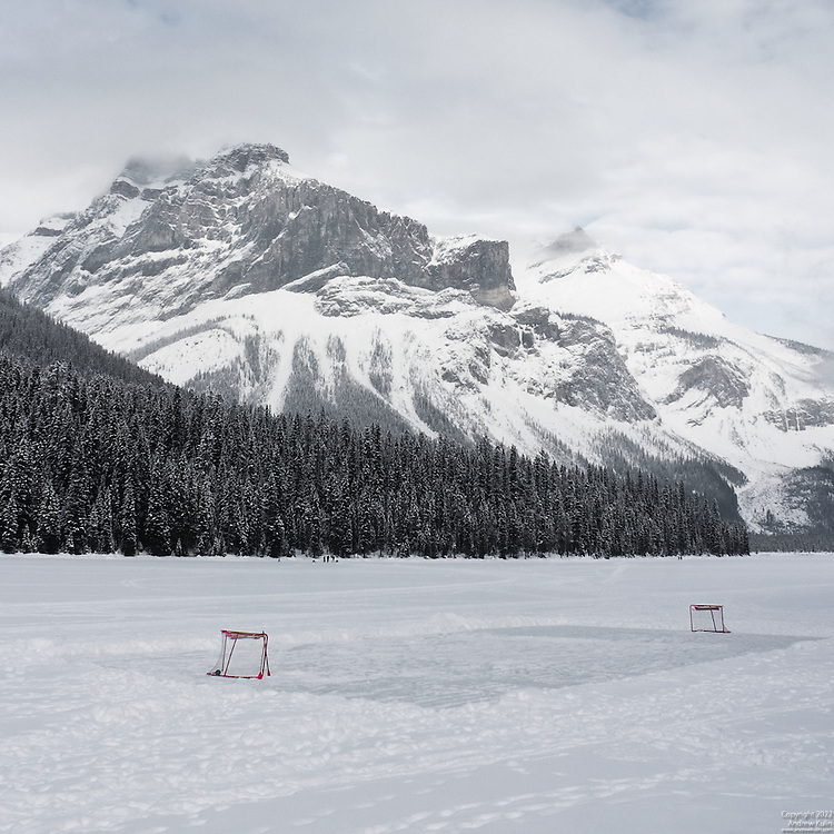 This photograph is of a rink located on the ice of Emerald Lake in Yoho National Park.  It was taken during the Christmas season in 2004 at the time of the NHL Player Strike which resulted in the cancellation of the entire season.  The rink being empty struck me as symbolic of no hockey being played in Canada.