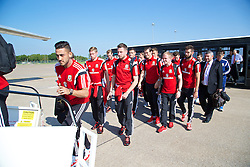 CARDIFF, WALES - Sunday, September 7, 2014: Wales' Neil Taylor, Paul Dummett, Gareth Bale and Jonathan Williams board the plane at Cardiff Airport as the squad flies to Andorra ahead of the opening UEFA Euro 2016 qualifying match. (Pic by David Rawcliffe/Propaganda)