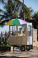 Ipanema Beach, Rio de Janiero, Brazil. A churros vendor cart on the calcadao.