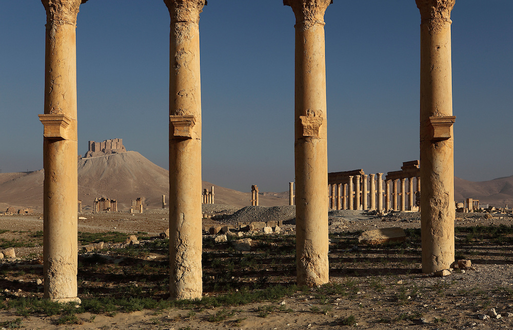 View of the Arab castle from the archaeological site of the ancient city of Palmyra, Syria. Palmyra was an important city of central Syria, located in an oasis 215 km northeast of Damascus and 180 km southwest of the Euphrates river. It had long been a vital caravan city for travelers crossing the Syrian desert and was known as the Bride of the Desert.