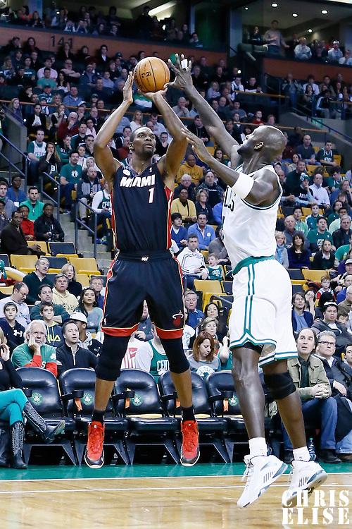 27 January 2013: Miami Heat center Chris Bosh (1) takes a jumpshot over Boston Celtics power forward Kevin Garnett (5) during the Boston Celtics 100-98  2OT victory over the Miami Heat at the TD Garden, Boston, Massachusetts, USA.