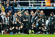 Jonjo Shelvey (#8) of Newcastle United celebrates Newcastle United's second goal (2-2) with Newcastle UNited team mates during the Premier League match between Newcastle United and Manchester City at St. James's Park, Newcastle, England on 30 November 2019.