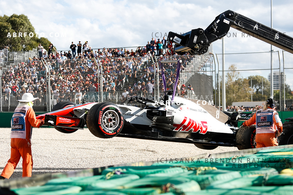 Haas driver Romain Grosjean of France car gets taken off the track after a mechanical failure during the 2018 Rolex Formula 1 Australian Grand Prix at Albert Park, Melbourne, Australia, March 24, 2018.  Asanka Brendon Ratnayake