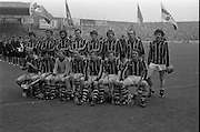 All Ireland Hurling Final - Cork vs Kilkenny.05.09.1982.09.05.1982.5th September 1982.Photographs taken at the final In Croke Park, Dublin. Kilkenny were the winners with a score of 3.18 to 1.7 for Cork..Here Kilkenny pose for the traditional team photograph. In the background is the Artane Boys Band