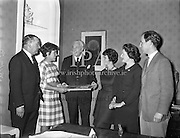 Mrs Pat Moss, the British racing driver's wife, is presented with sweaters.<br /> 06.04.1961
