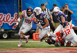 TCU Horned Frogs running back Aaron Green (22) scores past Mississippi Rebels defensive back Cody Prewitt (25) in the first half of the Ole Miss vs. TCU Chick-fil-A Peach Bowl football game at the Georgia Dome on December 31, 2014. David Tulis / Abell Images for the Chick-fil-A Bowl