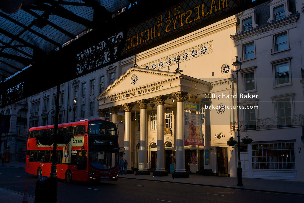 Red London bus passing the sunlit exterior of the Haymarket Theatre in central London. The Theatre Royal, Haymarket (also known as Haymarket Theatre or the Little Theatre) is a West End theatre in the Haymarket in the City of Westminster which dates back to 1720, making it the third-oldest London playhouse still in use.