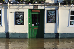 © Licensed to London News Pictures. 26/12/2013<br /> Drakes bar entrance.<br /> Maidstone Town Centre,Maidstone,Kent is flooded due to the <br />  river Medway Bursting its banks.<br /> Boxing day flooding in Kent.<br /> Large parts of Kent are still flooded due to heavy rain with more bad weather expected.<br /> Photo credit :Grant Falvey/LNP