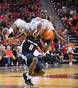 LAS VEGAS, NV - JANUARY 06:  Cheikh Mbacke Diong #34 of the UNLV Rebels lands on DeAngelo Isby #0 of the Utah State Aggies during their game at the Thomas & Mack Center on January 6, 2018 in Las Vegas, Nevada. Utah State won 85-78.  (Photo by Sam Wasson/Getty Images)