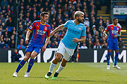 Crystal Palace defender Scott Dann (6) and Manchester City forward Sergio Aguero (10) during the Premier League match between Crystal Palace and Manchester City at Selhurst Park, London, England on 14 April 2019.