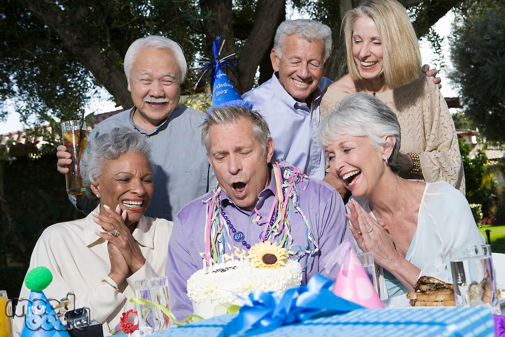 Senior couples celebrating birthday party in garden