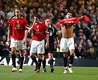Photo: Ed Godden.<br />Manchester United v Wigan Athletic. The Carling Cup Final. 26/02/2006. Cristiano Ronaldo puts his shirt back on after celebrating his goal.