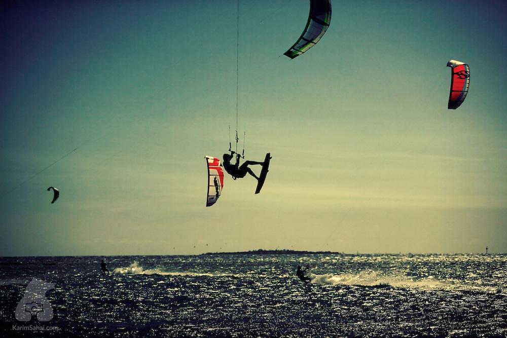 Kitesurfers at Ouen Toro bay, Noumea, New Caledonia.