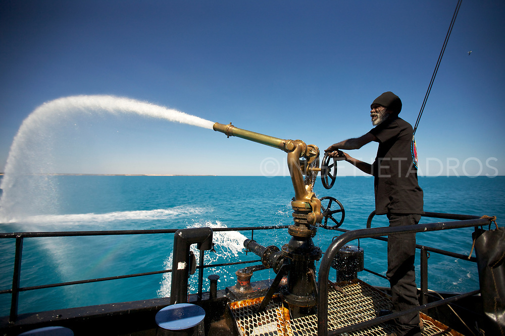 Richard Hunter trying out the water gun on Seashepherd's Vessel 'Steve Irwin' during Operation Kimberley Miinimbi which is the Goolarabooloo name for humpback whale. Broome, WA