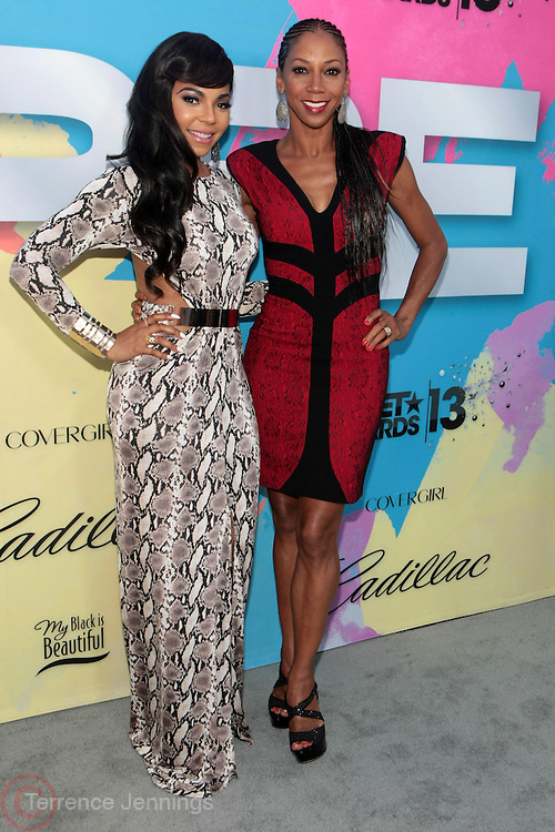 """Los Angeles, CA-June 29:  (L-R) Recording Artist/Actress Ashanti Shequoiya Douglas and Actress Holly Robinson-Peete attend the Seventh Annual """" Pre """" Dinner celebrating BET Awards hosted by BET Network/CEO Debra L. Lee held at Miulk Studios on June 29, 2013 in Los Angeles, CA. © Terrence Jennings"""