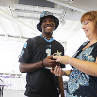 Jimmy Willis accepts an award from Star News Editor Sherry Jones for the 15 Under 15 project Sunday September 14, 2014 at Jungle Rapids in Wilmington, N.C. (Jason A. Frizzelle)