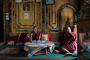 Myanmar. Monks at Shwe Yaunghwe Kyaung Monastery, a wooden monastery near Inle Lake.