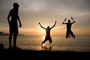 Local boys jumping of the Malecón in La Habana, Cuba.