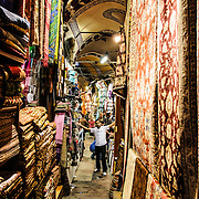 Turkish carpets line the walls outside shops in one of the narrow outlying streets of Istanbul's historic Grand Bazaar