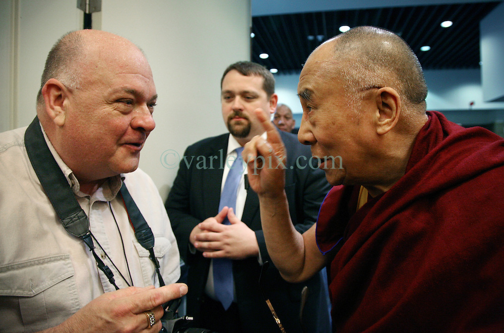 17 May 2013. New Orleans, Louisiana,  USA..Willie Herp, publisher of SENLA Focus jokes with His Holiness the 14th Dalai Lama at the press conference preceeding the 'Resiliance - Strength through Compassion and Connection' conference. Herp complimented His Holiness on his hair, to which His Holiness tugged on a long white hair in his eyebrow. He explained that it was for sure a sign of ageing and with age comes a great deal of wisdom - either that or we just get more stupid. His Holiness slapped Herp on the shoulder and quipped he hoped he could count himself in the former bracket.Photo; Charlie Varley.