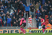 Ricardo Santos (12) of Peterborough United celebrates scoring to go 2-1 up by taking his shirt off  during the Sky Bet League 1 match between Doncaster Rovers and Peterborough United at the Keepmoat Stadium, Doncaster, England on 19 March 2016. Photo by Ian Lyall.