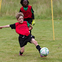 Eddie Shaw reaches for the ball during the Avenue Utd Summer Soccer Camp