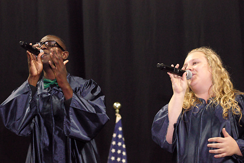 Colton Jones (left) and Megan Florence perform during the 29th annual Kettering Fairmont High School commencement at the Nutter Center in Fairborn, Thursday, May 31, 2012.