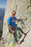 """Portrait of Conrad Anker belaying during an ascent of """"Fancy Free"""" (10b) on """"The Charlatan,"""" in The Needles of Southern California."""