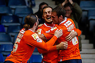 Luke Wilkinson of Luton Town (centre) celebrates scoring the opening goal against Newport County with Luke Rooney of Luton Town (left) and Andy Drury of Luton Town (right) during the Sky Bet League 2 match at Kenilworth Road, Luton<br /> Picture by David Horn/Focus Images Ltd +44 7545 970036<br /> 20/12/2014