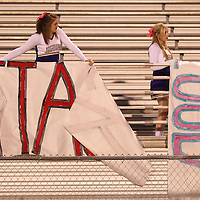 Adam Robison | BUY AT PHOTOS.DJOURNAL.COM<br /> DeSoto Central Cheerleaders MaKenzie McIntyre and Amber Kaminski put up banners on the stands before kickoff Friday night in Tupelo.