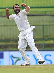 August 14, 2017 - Colombo, Sri Lanka - Indian cricketer MOHAMMED SHAMI celebrates after taking the wicket of Sri Lanka's Kusal Mendis (unseen) during the 3rd Day's play in the 3rd and final Test match between Sri Lanka and India at the Pallekele international cricket stadium at Kandy, Sri Lanka. (Credit Image: © Tharaka Basnayaka/NurPhoto via ZUMA Press)
