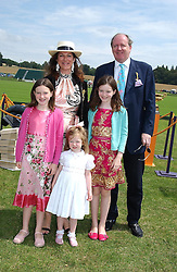 The HON.CHRISTOPHER & MRS GILMOUR with their daughters (Tall to short) LEONORA, GABRIELLA and CHRISTABELLE at the Veuve Clicquot sponsored Gold Cup or the British Open Polo Championship won by The  Azzura polo team who beat The Dubai polo team 17-9 at Cowdray Park, West Sussex on 18th July 2004.