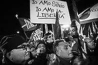 Supporters of Silvio Berlusconi gather at his private residence in Rome to listen to his last speech as a Senator during which he  declared himself a victim of persecution, on November 27th 2013. One hour later, the Senate voted to expel him from Parliament over his tax fraud conviction.