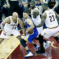 08 June 2016:  Cleveland Cavaliers forward Richard Jefferson (24), Cleveland Cavaliers guard Kyrie Irving (2) and Cleveland Cavaliers forward LeBron James (23) defend on Golden State Warriors guard Stephen Curry (30) during the Cleveland Cavaliers 120-90 victory over the Golden State Warriors, during Game Three of the 2016 NBA Finals at the Quicken Loans Arena, Cleveland, Ohio, USA.