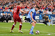 May 24, 2017: Sydney FC George Blackwood (19) and Liverpool FC player Lucas Leiva (21) battle for the ball at the soccer match, between English Premiere League team Liverpool FC and Sydney FC, played at ANZ Stadium in Sydney, NSW Australia.