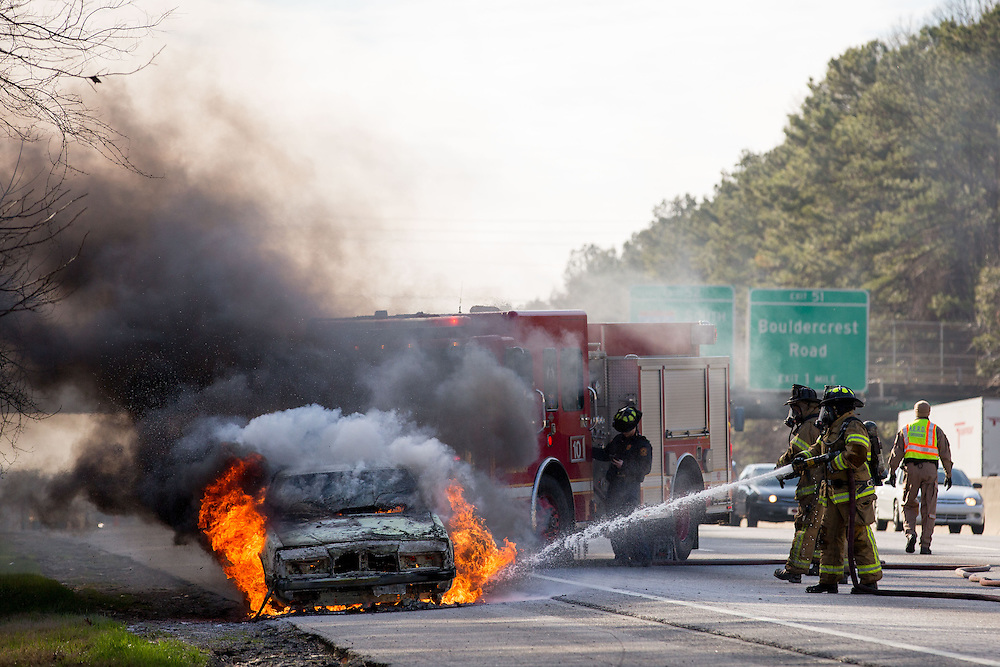 The Chrysler New Yorker of Coree Lee of Jonesboro burns on I-285 in Atlanta on Jan. 7, 2015 in Atlanta, Ga. Dekalb County Fire put the fire out.