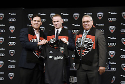 English international soccer player Wayne Rooney (C) poses with Jason Levien, United Managing Partner and CEO<br /> and Dave Kasper (R) , United General Manager and VP of Soccer Operations during the media unveiling at the Newseum on July 2, 2018 in Washington, DC..Photo by Olivier Douliery/ Abaca Press