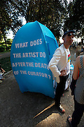 """What does the artist do after the death of the curator?"""