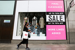 © Licensed to London News Pictures. 09/08/2019. London, UK. A shopper walks past a window display on Regents Street in London as UK retailers experience worst July since sales records began. Photo credit: Dinendra Haria/LNP